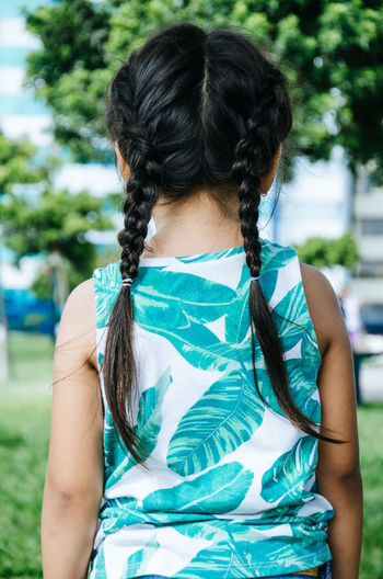 Braids of a girl in the park Adult Beautiful Braids Care Fashion Hair Young America Background Beauty Black Braid Braided Braiding Caucasian Female Girl Girls Hairstyle People person Portrait Salon Style White