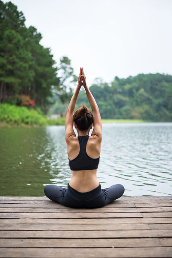 Woman sitting in a lake