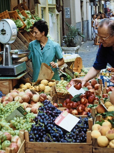Venice, Italy - Restaurant chef buying fruit from a local market A Taste Of Venice, Italy Fruit And Veg For Sale Italian Vegetables Venice Italy Abundance Adult Adults Only Casual Clothing Day Food Food And Drink Freshness Fruit Grape Grapes For Sale Healthy Eating Market Men Outdoors People Real People Supermarket Two People Variation Vegetable Weighing Machine Young Adult Business Stories Stories From The City My Best Travel Photo A New Beginning Autumn Mood