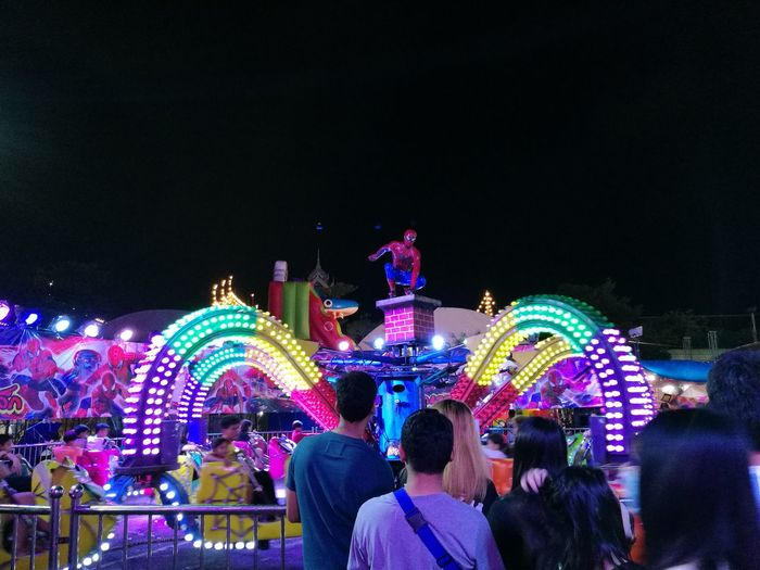 Spiderman come the temple fair for what? Night Arts Culture And Entertainment Crowd Large Group Of People Amusement Park Fun Enjoyment Illuminated Celebration Nightlife People Leisure Activity Performance Excitement Lifestyles Adults Only Real People Women