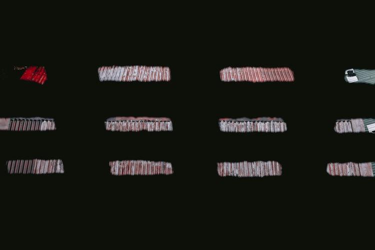Full frame shot of illuminated text against black background