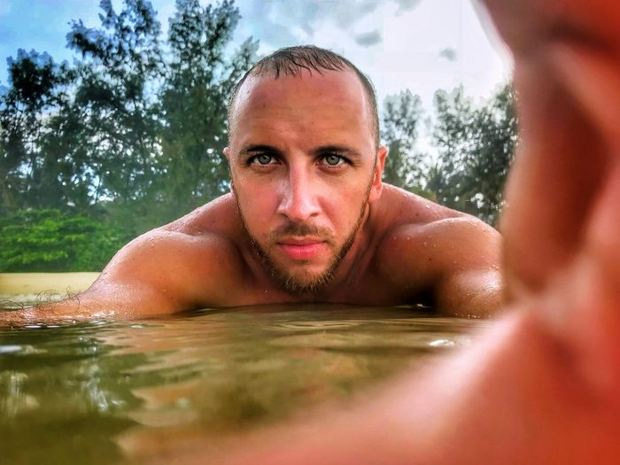 Portrait of young man in swimming pool