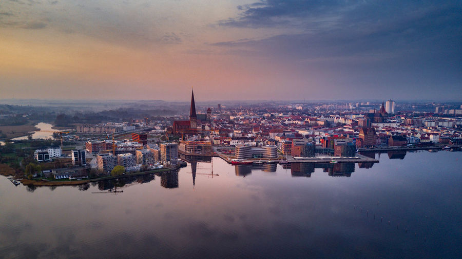 aerial view of rostock Drone  Rostock Aerial View Architecture Building Building Exterior Built Structure City Cityscape Cloud - Sky High Angle View Nature No People Outdoors Reflection Residential District River Sky Sunset Travel Destinations Water Waterfront