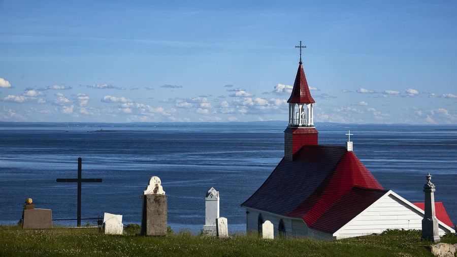 The Red Chapel Quebec The Week On EyeEm Architecture Building Exterior Built Structure Canada Cemetery Cross Day Horizon Over Water Nature No People Outdoors Place Of Worship Religion Sea Sky Spirituality Water