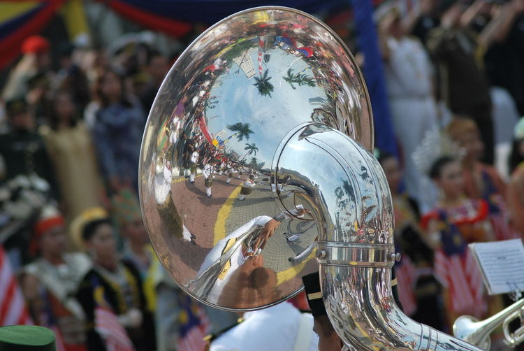 Close-up of sousaphone against people during celebration
