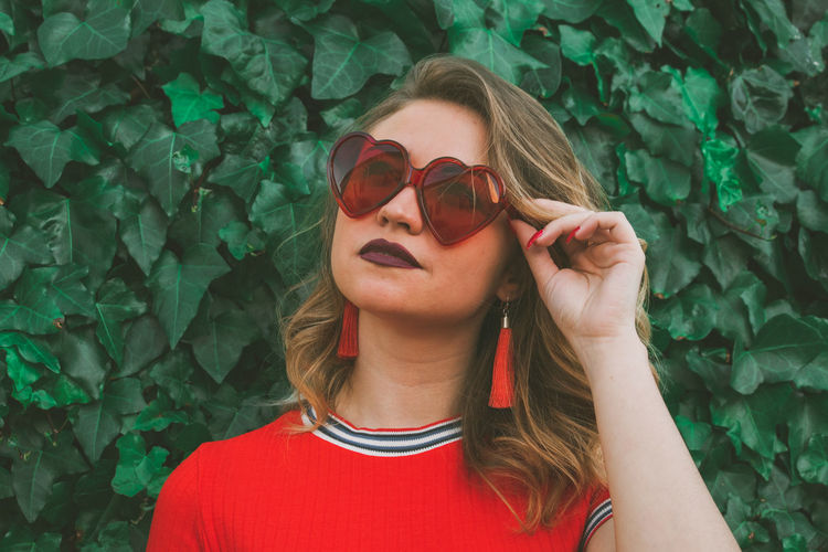 Portrait of young woman wearing sunglasses outdoors