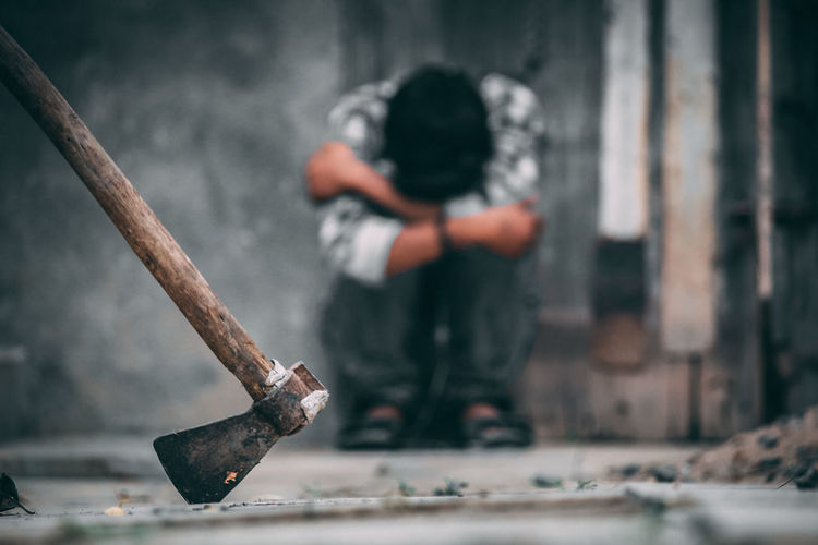 Axe Crying Sadness Boy Violence Child Childhood Day Emotion Focus On Foreground Hand Men People Real People Sadness Social Issues Domestic Violence Child Abuse Abuse Beaten Up Grief Kid