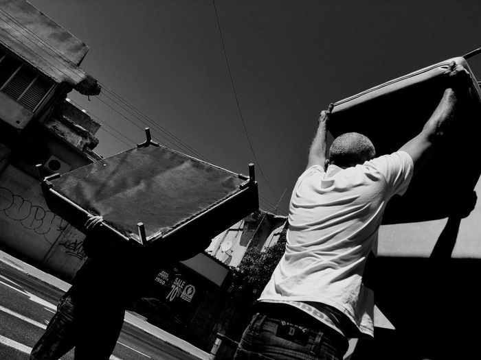 Real People Rear View Men Outdoors Day Lifestyles Two People Leisure Activity Low Angle View Togetherness Sky Adult People Working Heat Streetphotography Blackandwhite Strength The Street Photographer - 2017 EyeEm Awards BYOPaper! The Street Photographer - 2017 EyeEm Awards Live For The Story Action Let's Go. Together. Urbanphotography Connected By Travel Black And White Friday Stories From The City A New Beginning The Art Of Street Photography