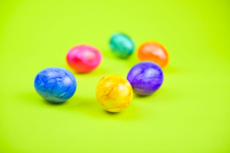Colored Background Studio Shot Multi Colored Green Background Food Easter Egg Easter Indoors  Food And Drink Close-up No People Still Life Celebration Copy Space Holiday Egg Group Of Objects Temptation Decoration Bright Colorful