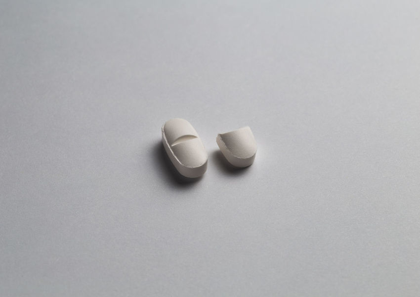 close up of a group of pills in isolated background Medicine Healthcare And Medicine White Background Pill Dose Studio Shot Still Life Indoors  Copy Space No People High Angle View Two Objects White Color Cut Out Close-up Simplicity Capsule Prescription Medicine Gray Directly Above Blister Pack