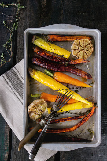 Black Backround Dark Dinner Time Herbs Tray Baked Carrots Carrot Carrots Colorful Vegetables Colors Of Food Different Directly Above Food Grilled Vegetables Healthy Eating Healthy Food Rustic Style Top View Of Food Variety Vegan Food Vegetables Veggies Wooden Texture Yellow Carrots