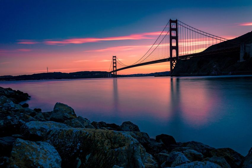 Golden Gate Bridge at Dusk Bridge - Man Made Structure Water Suspension Bridge Sky Architecture Built Structure Connection Sunset No People Nature Sea Engineering Outdoors Travel Destinations San Francisco San Francisco Bay California California Love Dusk Golden Gate Bridge The Architect - 2017 EyeEm Awards Colour Your Horizn