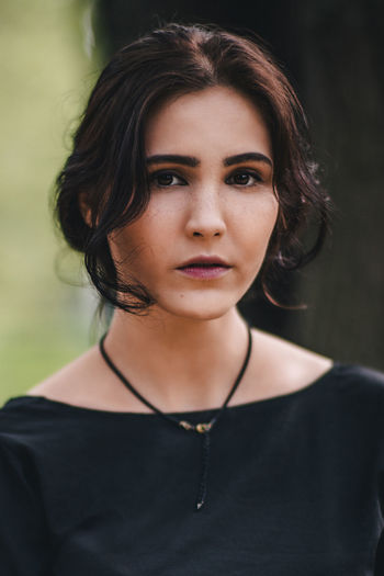 Woman close-up Adult Beautiful Woman Beauty Black Color Casual Clothing Close-up Contemplation Depression - Sadness Focus On Foreground Front View Hair Hairstyle Headshot Lifestyles Looking At Camera One Person Portrait Real People Serious Women Young Adult Young Women