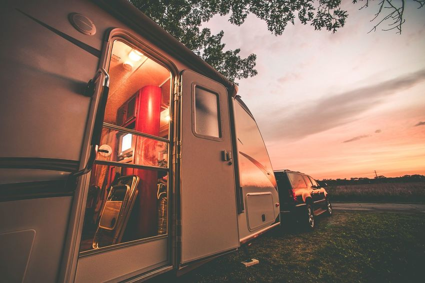 Travel Trailer Sunset Camping. Rving in Wisconsin, USA Rving Camper Day Land Vehicle Mode Of Transport Nature No People Outdoors Public Transportation Rail Transportation Rv Sky Sunset Train - Vehicle Transportation Travel Trailer Tree
