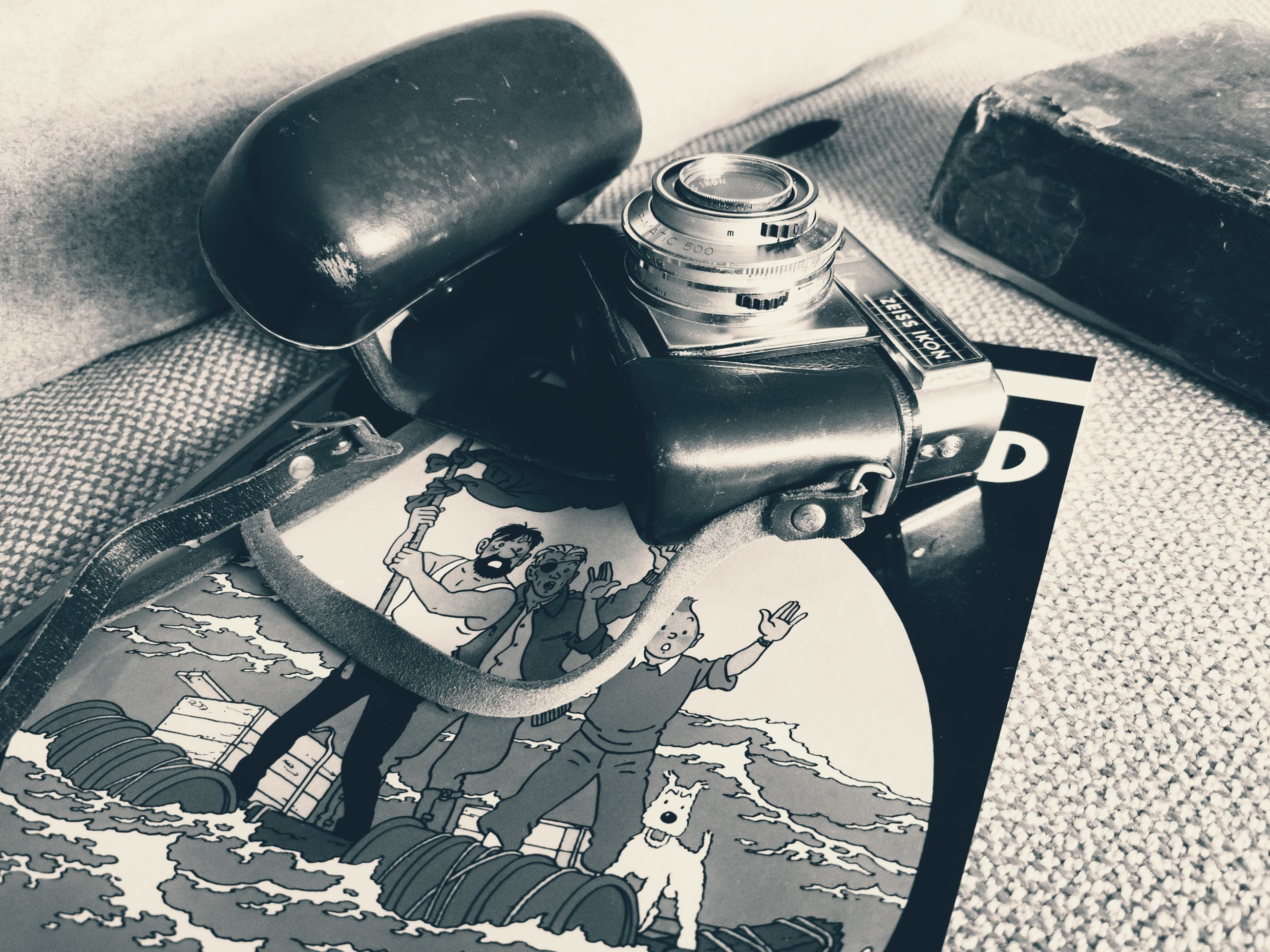 high angle view, indoors, still life, close-up, table, no people, metal, equipment, technology, watch, wristwatch, communication, photography themes, pen, retro styled, day, text, group, binoculars