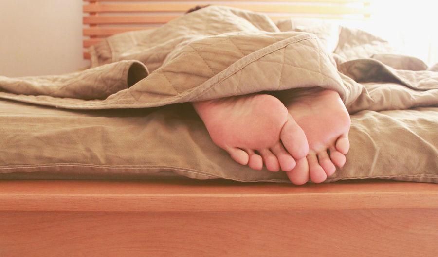 View of feet under bedding