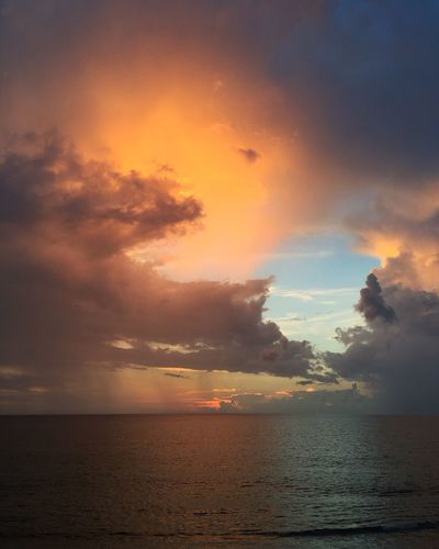 Sea Horizon Over Water Water Scenics Tranquil Scene Sunset Tranquility Beauty In Nature Sky Waterfront Idyllic Nature Seascape Cloud - Sky Cloud Orange Color Majestic Calm Dramatic Sky Non-urban Scene