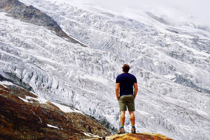Wall of Glacier Glacier Rear View Leisure Activity One Person Real People Lifestyles Full Length Mountain Scenics - Nature Beauty In Nature Snow Men Day Standing Cold Temperature Winter Nature Adventure Hiking Mountain Range Outdoors