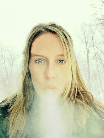 Winter Weather Frosty Breathing Breath EyeEm Best Shots - Winter Looking At Camera Blue Eyes Cold Weather Cold Temperature It's Cold Outside Rebel Rebel Smoking Smoking Girls Exhale Pastel Power Cold Breath Showcase March Selfies Selfie That's Me! That's Me Girl With Blue Eyes Hello World The Portraitist - 2016 EyeEm Awards Blue Wave