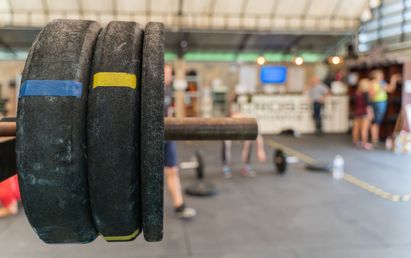 Close-Up Of Weights On Barbell In Gym