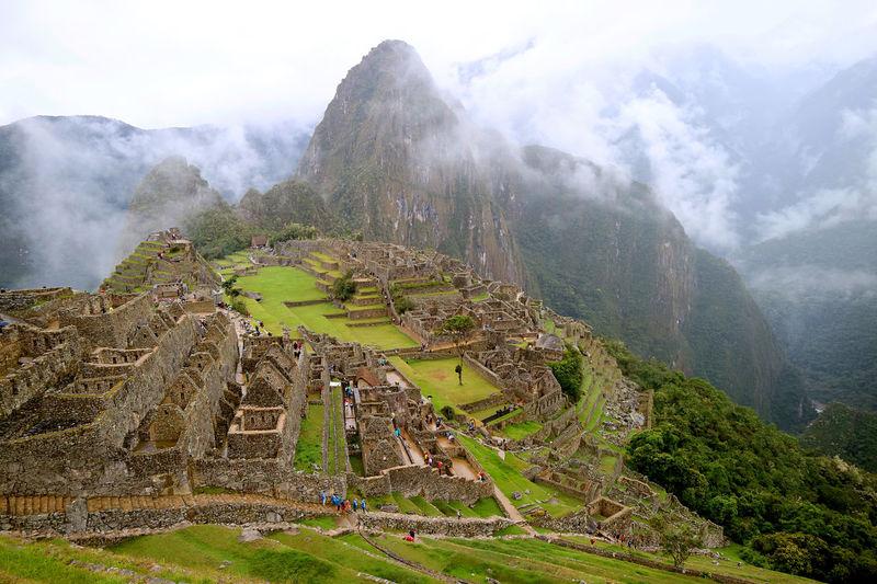 Machu picchu in the light rain, the incredible inca citadel in urubamba province, cusco region, peru