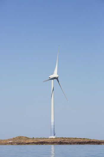 Wind turbines against clear blue sky