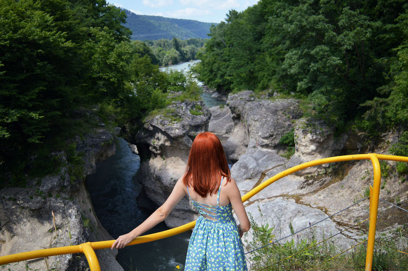 High Angle View Of Woman Standing At Observation Point Against River