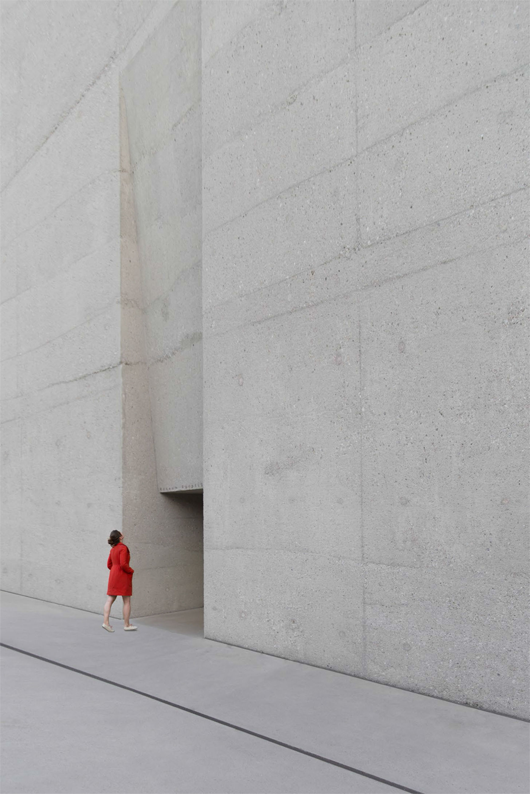 architecture, built structure, building exterior, red, wall - building feature, walking, lifestyles, full length, wall, standing, men, leisure activity, day, street, person, outdoors, rear view, casual clothing