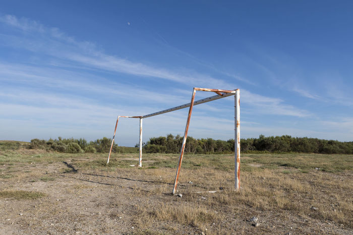 Football Goal Absence Blue Cloud - Sky Day Environment Field Grass Land Landscape Metal Nature No People Outdoors Plant Scenics - Nature Sky Sunlight Tranquil Scene Tranquility Wood - Material