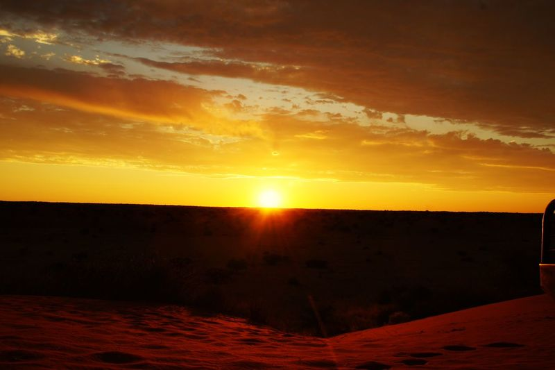 Some people only see this every view months, but in Namibia you see this every day. EyeEmNewHere Kalahari Wanderlust Travel Africa Namibia Desert Sunset Sky Scenics - Nature Orange Color Tranquility Tranquil Scene Cloud - Sky Beauty In Nature Sun Sunlight Idyllic Nature Horizon No People Land First Eyeem Photo