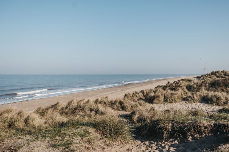 Panoramic view from the hill over hemsby beach, norfolk, uk, on a sunny spring day.
