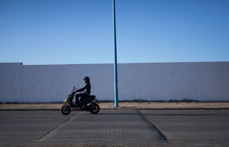 a casa road Motorcycle Wall Biker Blue Blue Sky Clear Sky Day Driving Mode Of Transport Motorcycle One Person Riding Road Streetphotography Sunny