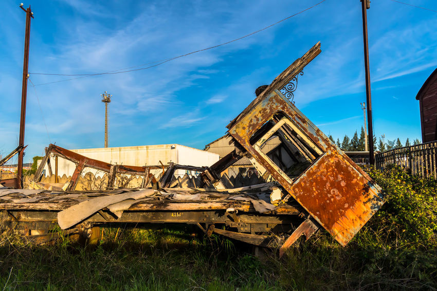 Abandoned Architecture Bad Condition Building Exterior Built Structure Cloud - Sky Construction Site Damaged Day Destruction Grass Industry No People Obsolete Old Outdoors Run-down Rusty Sky Train Train - Vehicle Transportation Weathered Wood - Material