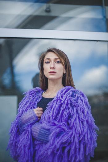 Portrait Of Young Woman Wearing Purple Fur Coat