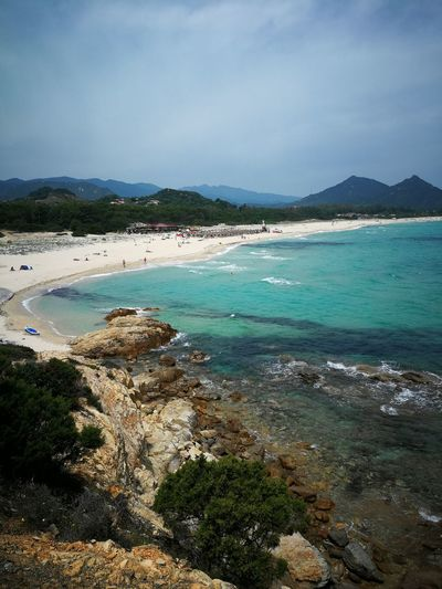 panoramic Sardinia Sardegna Italy  Sardinia Sardegna Water Sea Beach Sand Tourist Resort Sky Rocky Coastline Horizon Over Water Coast Coastline Shore Sandy Beach Seashore Seascape Rock Formation Rocky Mountains Calm