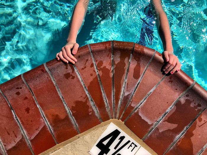 Pattern Arms Hands Playing Exercising Copy Space Brick Day Sunny Shallow Recreation  Swimming Pool Water High Angle View One Person Swimming Pool Lifestyles Real People Low Section Outdoors Day People