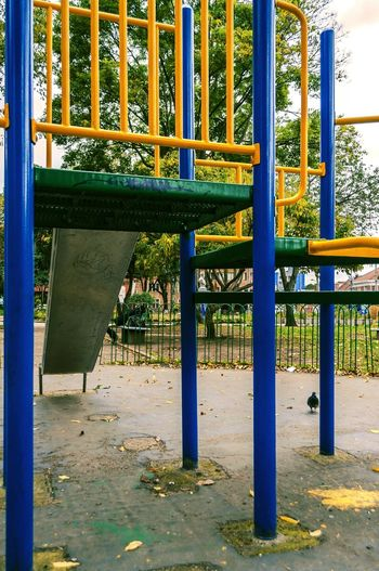 Close-up of empty bench in playground