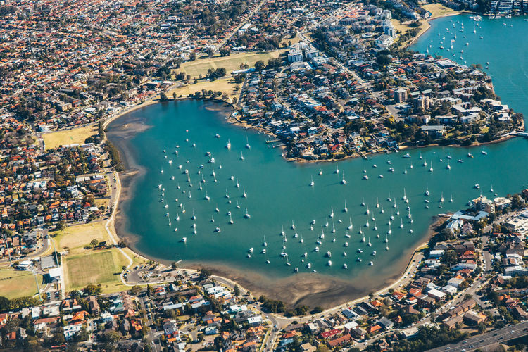 aerial view of cityscape in Australia Sydney, buildings and lake Sydney, Australia Aerial View Architecture Beach Building Building Exterior Built Structure City Cityscape Crowd Crowded Day High Angle View Land Nature Outdoors Residential District Sea Sydney Turquoise Colored Water