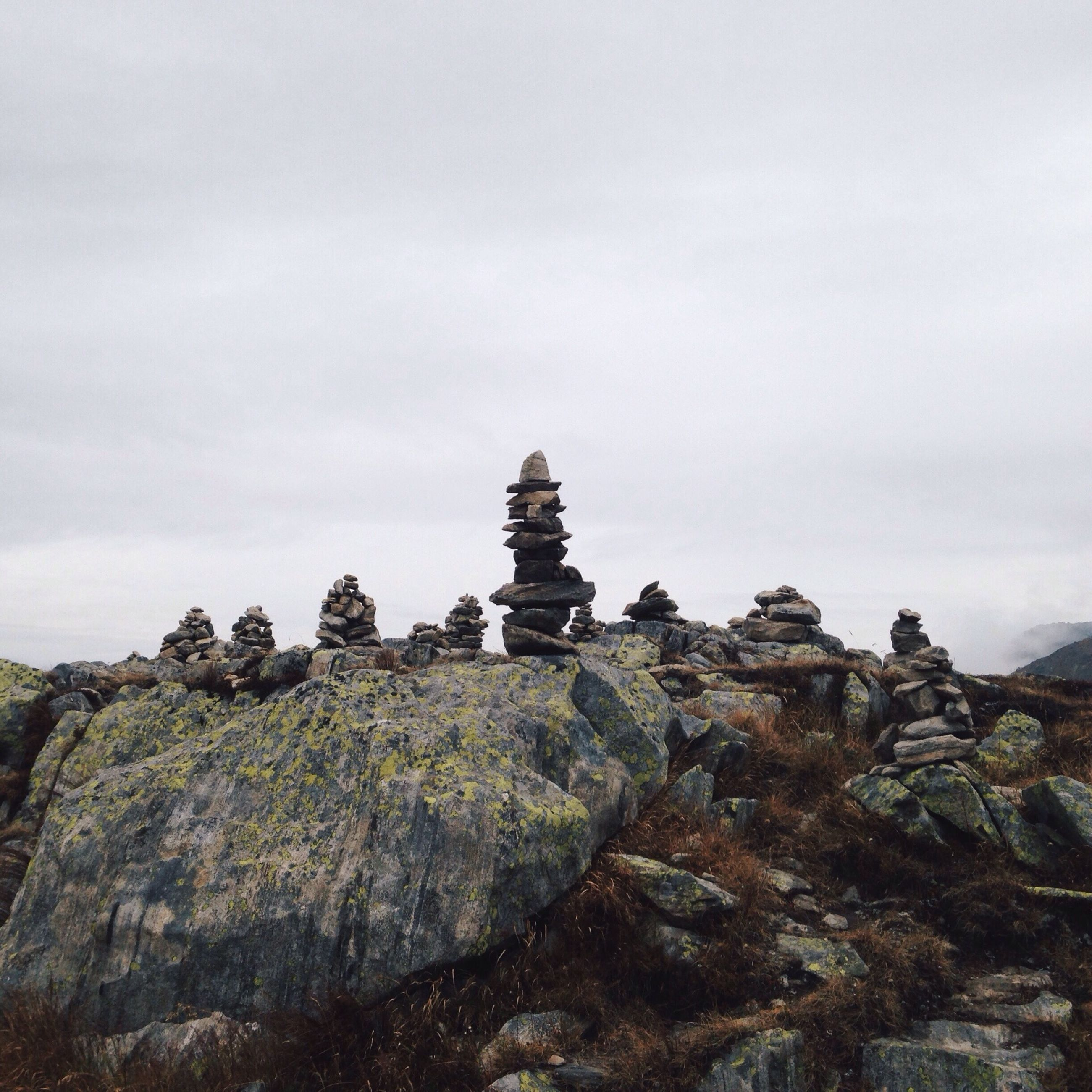 rock - object, sky, rock formation, low angle view, history, ancient, tranquility, old ruin, nature, tranquil scene, built structure, rock, copy space, architecture, the past, clear sky, geology, travel destinations, day, stone