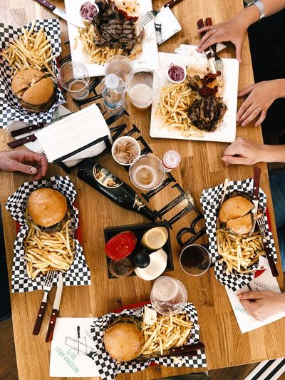 That lunch... Lunch Grill BBQ Beer Hands French Fries Meat Burgers High Angle View Table Large Group Of Objects Variation Indoors  Choice Still Life Food And Drink Directly Above Wood - Material Food
