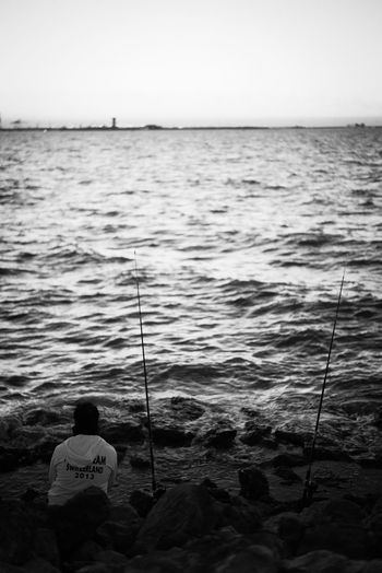 Fishing antenna. Weekend Activities Outdoors Horizon Over Water Fishing Water Leicacamera