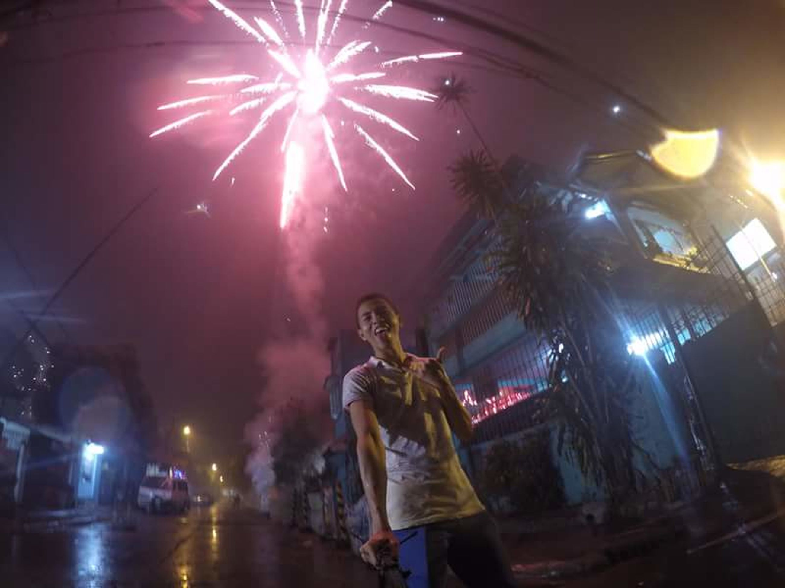 illuminated, night, celebration, firework display, arts culture and entertainment, exploding, event, firework - man made object, glowing, long exposure, motion, sparks, lighting equipment, low angle view, celebration event, blurred motion, lifestyles, men, building exterior