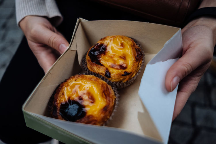 Pastel de Nata. The best snack at Porto Food Food And Drink Foodphotography Hands Pastel De Nata Streetphotography Yellow Human Hand Holding Hand Ready-to-eat One Person Freshness Human Body Part Sweet Food Indulgence Unhealthy Eating Sweet Dessert High Angle View Close-up Snack Baked