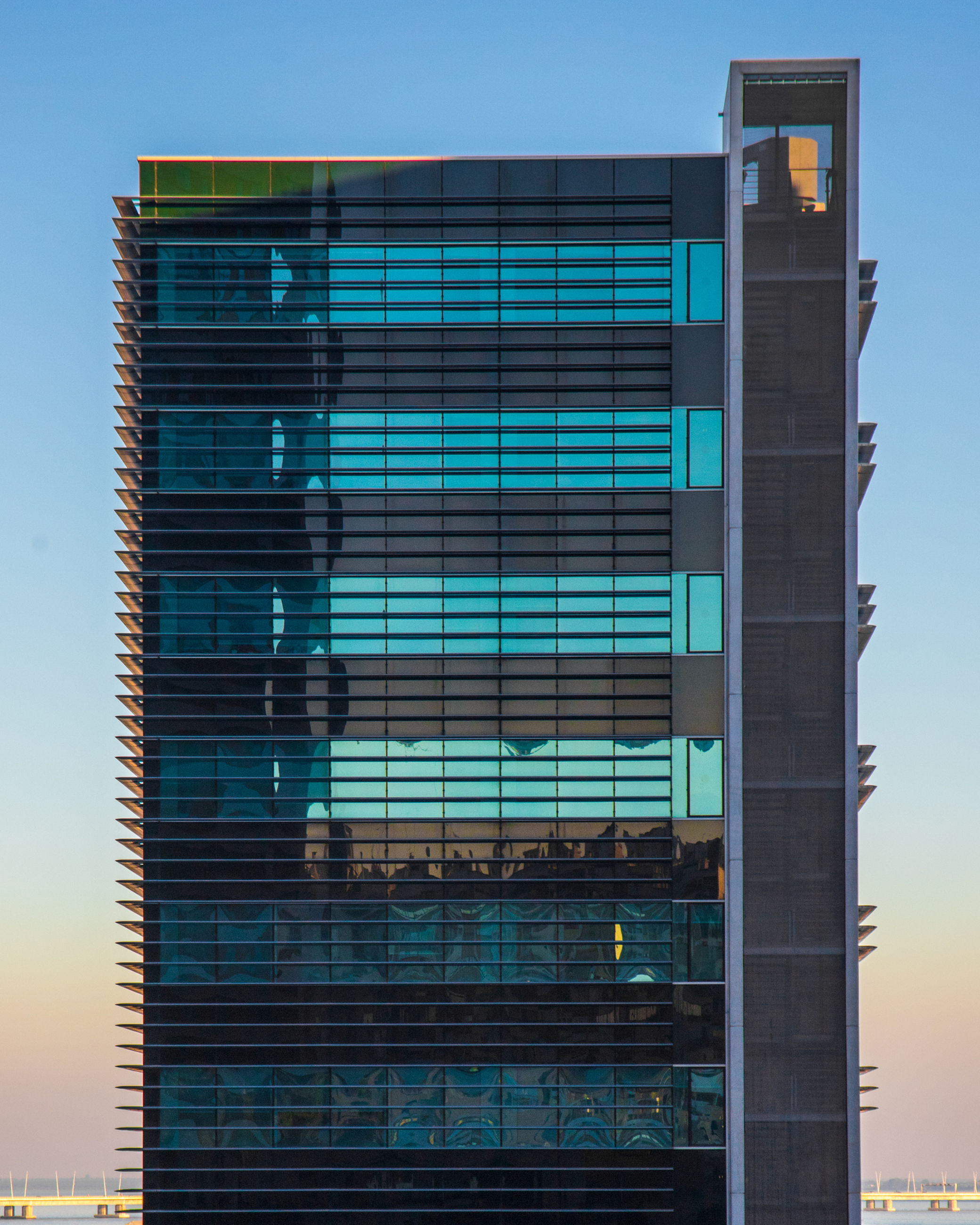 built structure, building exterior, architecture, modern, city, glass - material, office building exterior, low angle view, sky, building, no people, office, clear sky, reflection, outdoors, day, blue, illuminated, dusk, nature, skyscraper, financial district