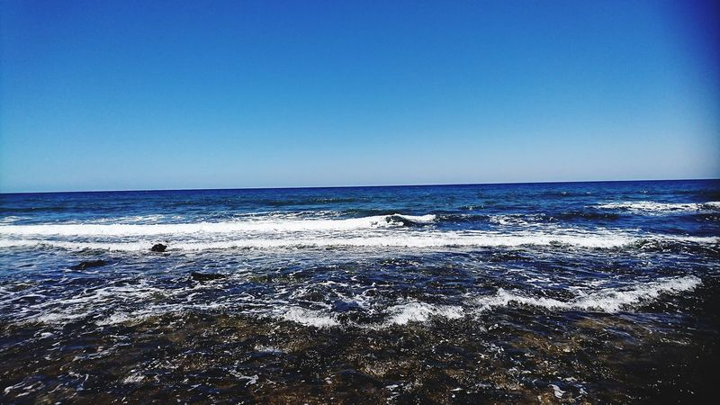 Sea And Sky Sea Pebbles On A Beach