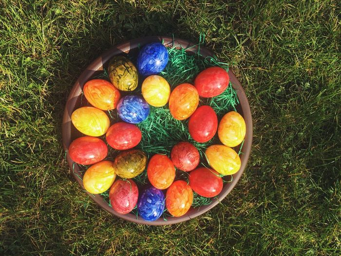 High Angle View Of Colorful Easter Eggs On Field