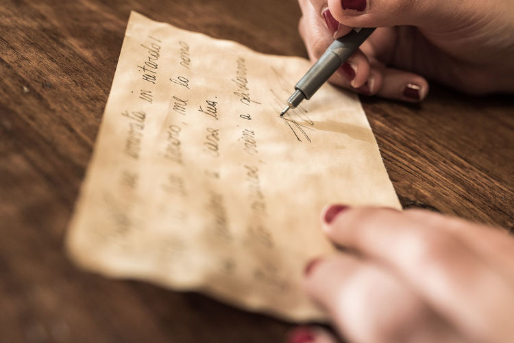 Adult Adults Only Close-up Day Fountain Pen Handwriting  Handwriting  Holding Human Body Part Human Hand Indoors  Ink Inked Nail One Man Only One Person Paper Pen Pen Art People Text Wooden Writing Writing