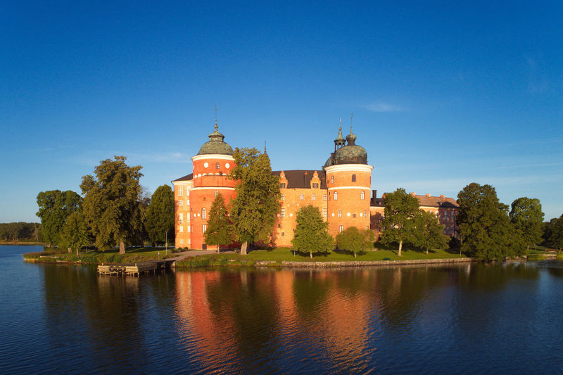 The Swedish Gripsholm castle Beautiful Castle Famous Gripsholm Mariefred Medellin City Sweden Architecture Blue Building Building Exterior Built Structure Clear Sky Copy Space History Landmark No People Old Outdoors Real People Sky Travel Destinations Tree Water Waterfront