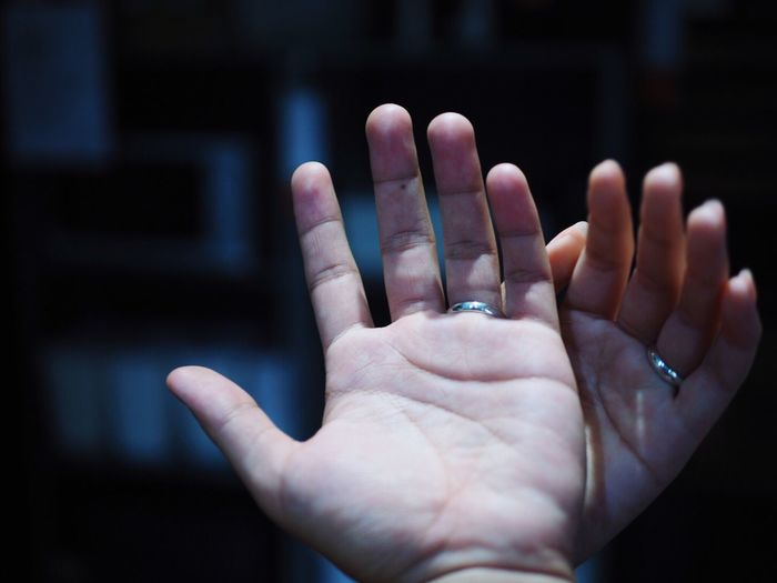 Close-up of cropped couple hands wearing wedding rings