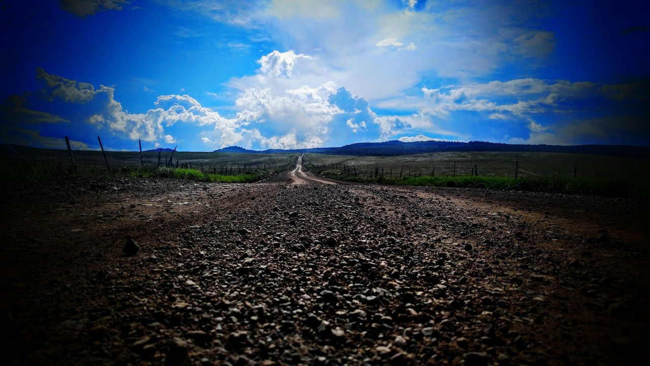 road, sky, scenics, the way forward, landscape, cloud - sky, nature, tranquility, tranquil scene, beauty in nature, transportation, no people, blue, day, outdoors, mountain